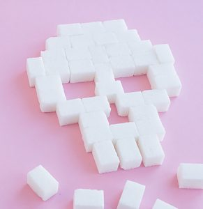Skull made out of sugar cubes on pink background Vista CA